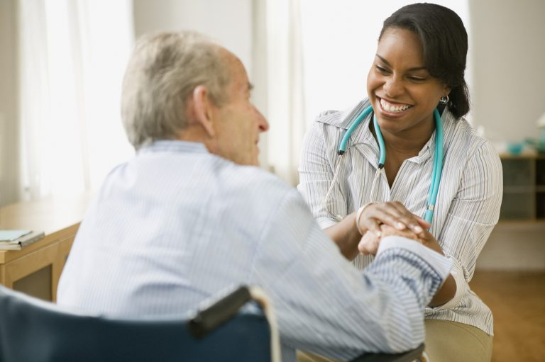 Woman doctor talks to older man