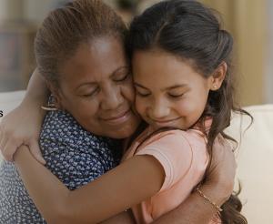 Woman hugging granddaughter
