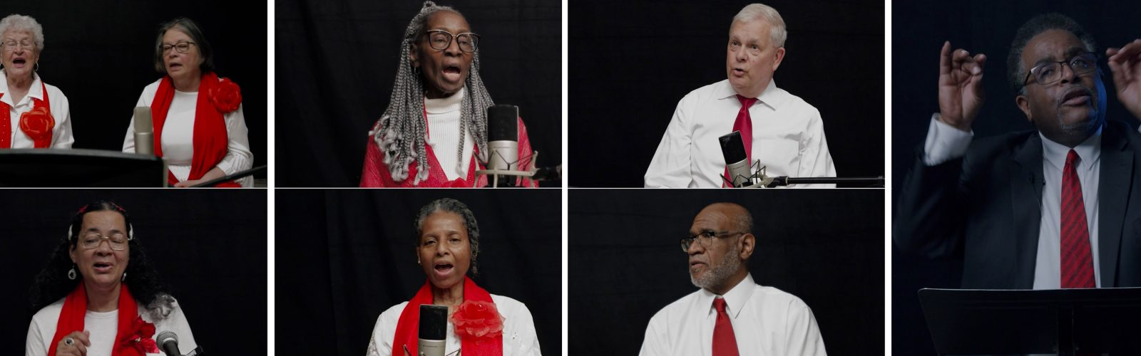 Chorus members sing in a virtual concert wearing matching red scarves and white shirts